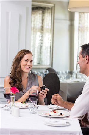 Man proposing a happy woman in the restaurant Stock Photo - Premium Royalty-Free, Code: 6109-07600960