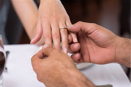 Hand putting a ring on the womans finger Stock Photo - Premium Royalty-Free, Code: 6109-07600961