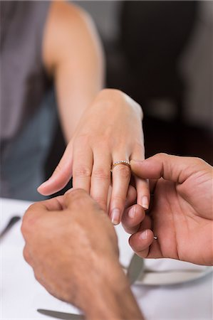 Hand putting a ring on the womans finger Stock Photo - Premium Royalty-Free, Code: 6109-07600962