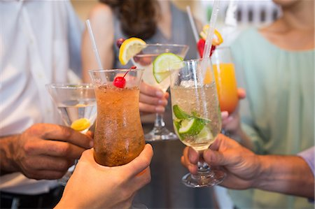 Closeup mid section of people toasting cocktails Stock Photo - Premium Royalty-Free, Code: 6109-07600925