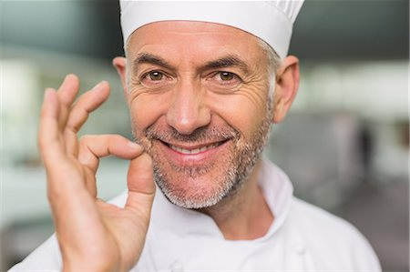 Happy chef looking at the camera making ok sign Stock Photo - Premium Royalty-Free, Code: 6109-07601040