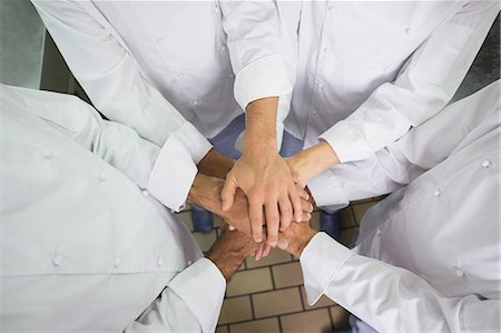 staff - Team of chefs putting their hands together Stock Photo - Premium Royalty-Free, Code: 6109-07601045
