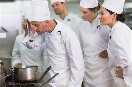 Head chef tasting a soup while staff watch Stock Photo - Premium Royalty-Free, Code: 6109-07601059