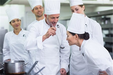 staff - Head chef giving a taste to another chef Stock Photo - Premium Royalty-Free, Code: 6109-07601060