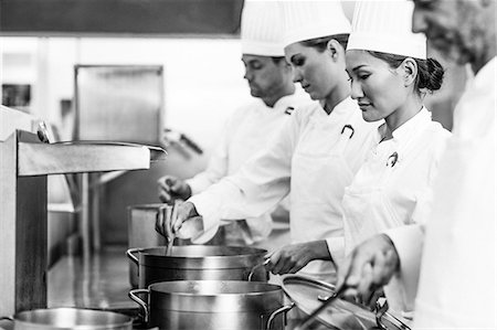 Row of chefs working at the stove Stock Photo - Premium Royalty-Free, Code: 6109-07601064