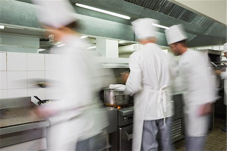 Busy team of chefs at work Stock Photo - Premium Royalty-Free, Code: 6109-07601068