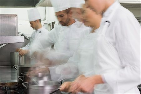 Busy team of chefs at work Stock Photo - Premium Royalty-Free, Code: 6109-07601069