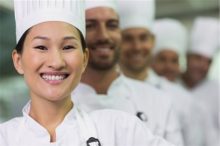 Happy team of chefs standing in line Stock Photo - Premium Royalty-Free, Code: 6109-07601073