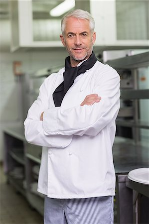Confident chef looking at the camera Stock Photo - Premium Royalty-Free, Code: 6109-07601034