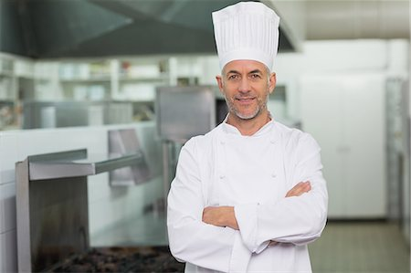 Confident chef looking at the camera Stock Photo - Premium Royalty-Free, Code: 6109-07601035