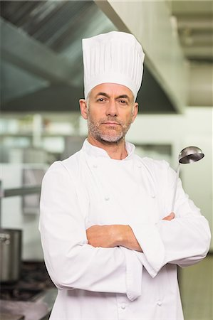 Confident chef looking at the camera Stock Photo - Premium Royalty-Free, Code: 6109-07601036