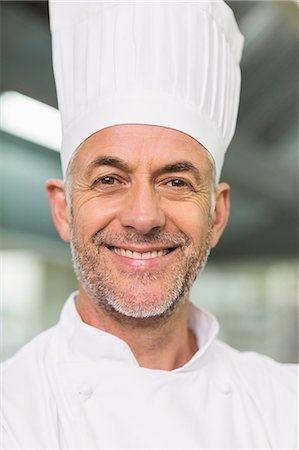 Happy chef looking at the camera Stock Photo - Premium Royalty-Free, Code: 6109-07601039