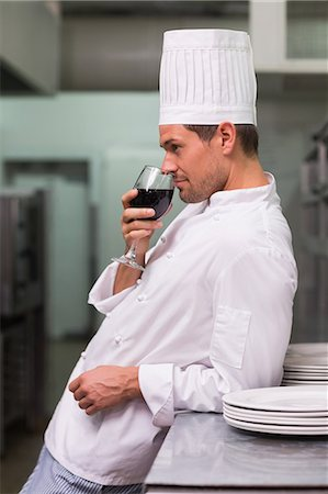 Chef relaxing with glass of red wine after work Stock Photo - Premium Royalty-Free, Code: 6109-07601168