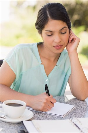 planner - Serious businesswoman having coffee and planning her week Stock Photo - Premium Royalty-Free, Code: 6109-07601199