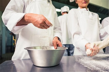 Chefs preparing dough at counter Stock Photo - Premium Royalty-Free, Code: 6109-07601105