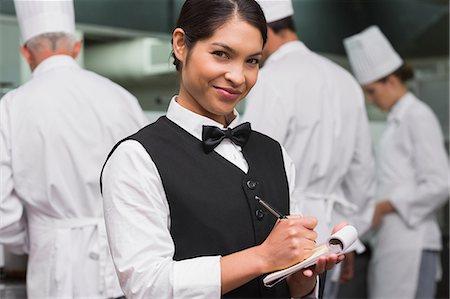 staff - Happy waitress writing on pad Stock Photo - Premium Royalty-Free, Code: 6109-07601135