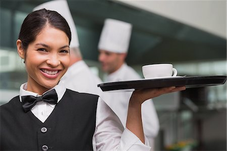 staff - Happy waitress holding tray with coffee cup Stock Photo - Premium Royalty-Free, Code: 6109-07601136