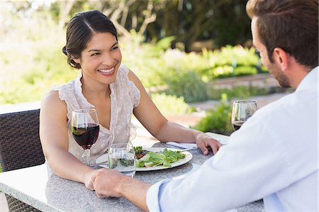 elegant - Happy couple holding hands on a date Stock Photo - Premium Royalty-Free, Code: 6109-07601217