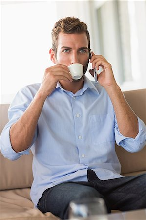 sit - Handsome businessman on a phone call and drinking espresso Stock Photo - Premium Royalty-Free, Code: 6109-07601215