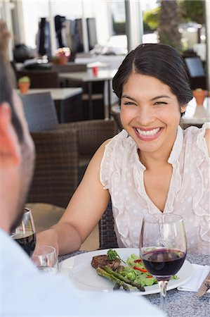 sitting - Happy woman smiling at her date Stock Photo - Premium Royalty-Free, Code: 6109-07601222