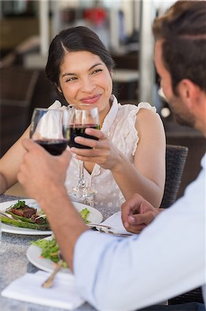 sitting - Happy couple on a date drinking red wine Stock Photo - Premium Royalty-Free, Code: 6109-07601225