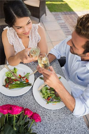 sit - Happy couple celebrating their anniversary with champagne Stock Photo - Premium Royalty-Free, Code: 6109-07601234