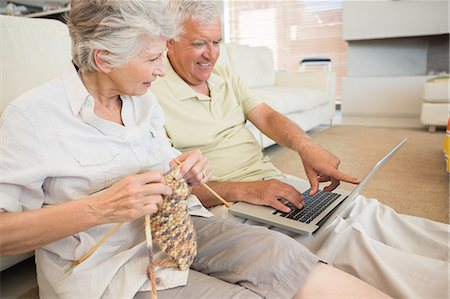 domestic life - Senior couple sitting on floor knitting and using laptop Stock Photo - Premium Royalty-Free, Code: 6109-07601462