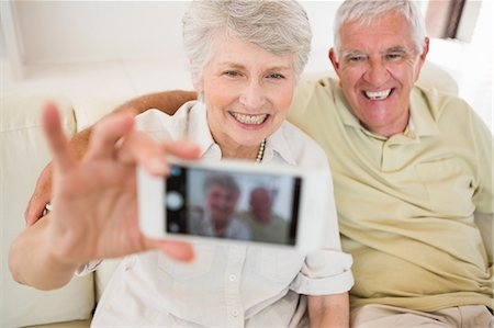 Senior woman taking a selfie with her smartphone Stock Photo - Premium Royalty-Free, Code: 6109-07601473