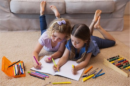 pretty draw - Siblings drawing in the living room Stock Photo - Premium Royalty-Free, Code: 6109-07601494