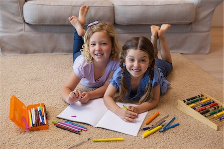 pretty pictures to draw - Full length portrait of siblings drawing in living room Stock Photo - Premium Royalty-Free, Code: 6109-07601495