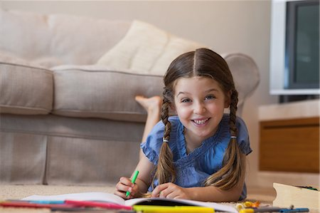 pretty pictures to draw - Portrait of a little girl drawing in living room Stock Photo - Premium Royalty-Free, Code: 6109-07601498