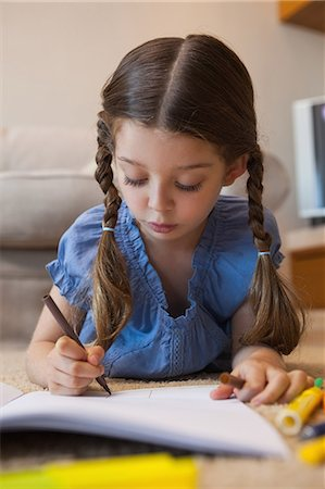 pretty pictures to draw - Close-up of a little girl drawing in living room Stock Photo - Premium Royalty-Free, Code: 6109-07601499