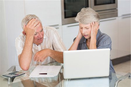 person overwhelmed stresss - Worried senior couple using the laptop to pay bills Stock Photo - Premium Royalty-Free, Code: 6109-07601403