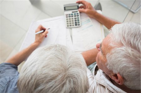 domestic life - Senior couple using the calculator to pay bills Stock Photo - Premium Royalty-Free, Code: 6109-07601405