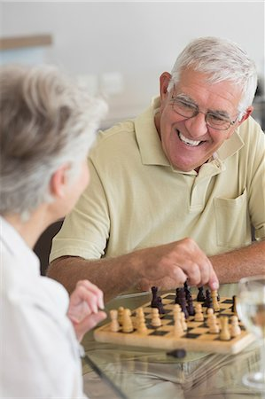 setting kitchen table - Senior couple playing chess and having white wine Stock Photo - Premium Royalty-Free, Code: 6109-07601427