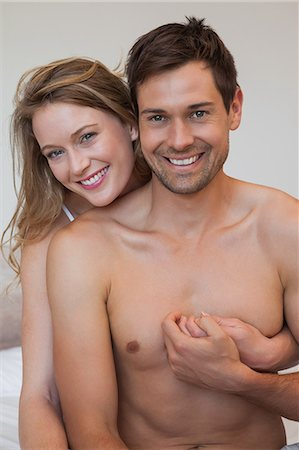 Portrait of loving relaxed couple in bedroom Stock Photo - Premium Royalty-Free, Code: 6109-07601549