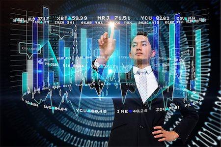 futuristic - Asian businessman pointing to data interface Stock Photo - Premium Royalty-Free, Code: 6109-07601576