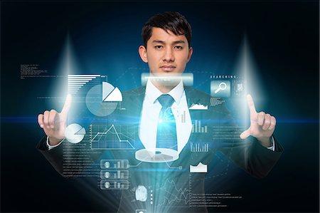 futuristic - Serious businessman touching interface Stock Photo - Premium Royalty-Free, Code: 6109-07601592