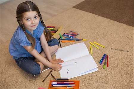 pretty draw - Full length of a little girl drawing in living room Stock Photo - Premium Royalty-Free, Code: 6109-07601503
