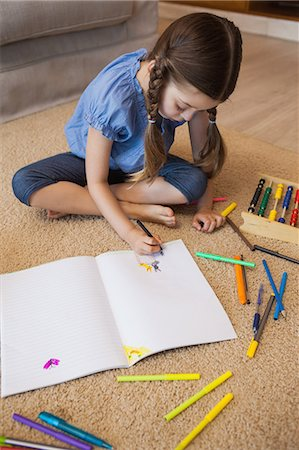 pretty draw - Full length of a little girl drawing in living room Stock Photo - Premium Royalty-Free, Code: 6109-07601501