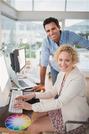 pretty draw - Smiling casual business team working together Stock Photo - Premium Royalty-Free, Code: 6109-08203183