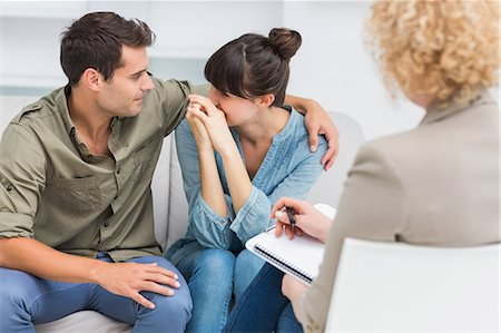 Psychologist helping a couple with relationship difficulties Stock Photo - Premium Royalty-Free, Code: 6109-08203204