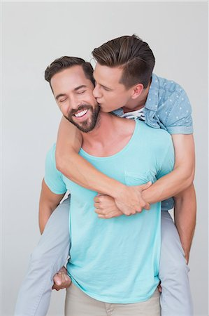 Happy homosexual couple kissing and having piggy back Stock Photo - Premium Royalty-Free, Code: 6109-08203699