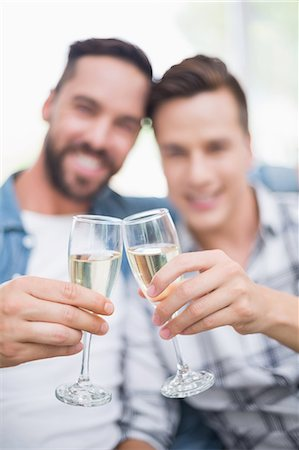 Homosexual couple men toasting with a champagne flute Stock Photo - Premium Royalty-Free, Code: 6109-08203608