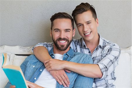 Homosexual couple men reading a book together Stock Photo - Premium Royalty-Free, Code: 6109-08203626