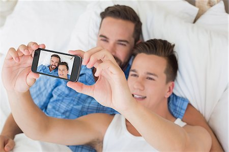 Happy homosexual taking a selfie Stock Photo - Premium Royalty-Free, Code: 6109-08203713