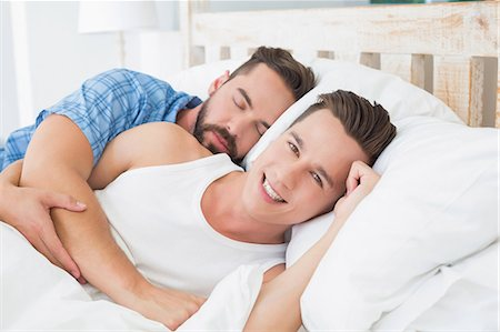 Homosexual couple lying on bed Stock Photo - Premium Royalty-Free, Code: 6109-08203710