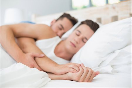 Homosexual couple sleeping on bed Stock Photo - Premium Royalty-Free, Code: 6109-08203711