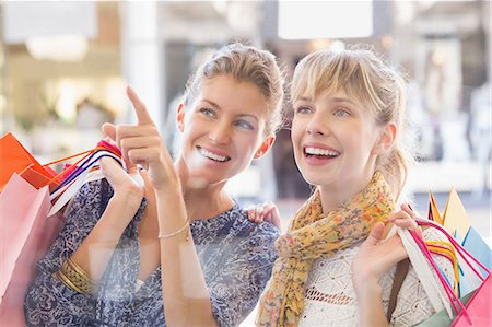 shopping mall - Beautiful women holding shopping bags looking at window Stock Photo - Premium Royalty-Free, Code: 6109-08204129