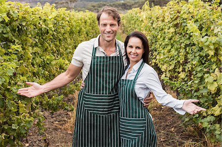 seasonal - Happy winegrower couple presenting their wineyard Stock Photo - Premium Royalty-Free, Code: 6109-08204207